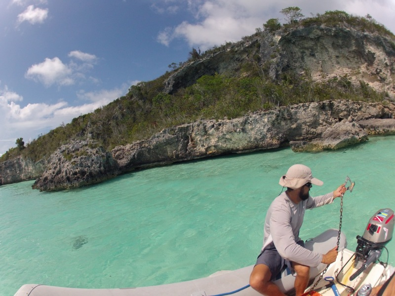 Throwing anchor to snorkel the rocky coast.