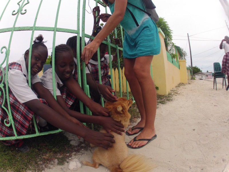 """Just steps onland, back in Great Harbor Cay and the kids are yelling, """"Foxy lady is back!"""""""